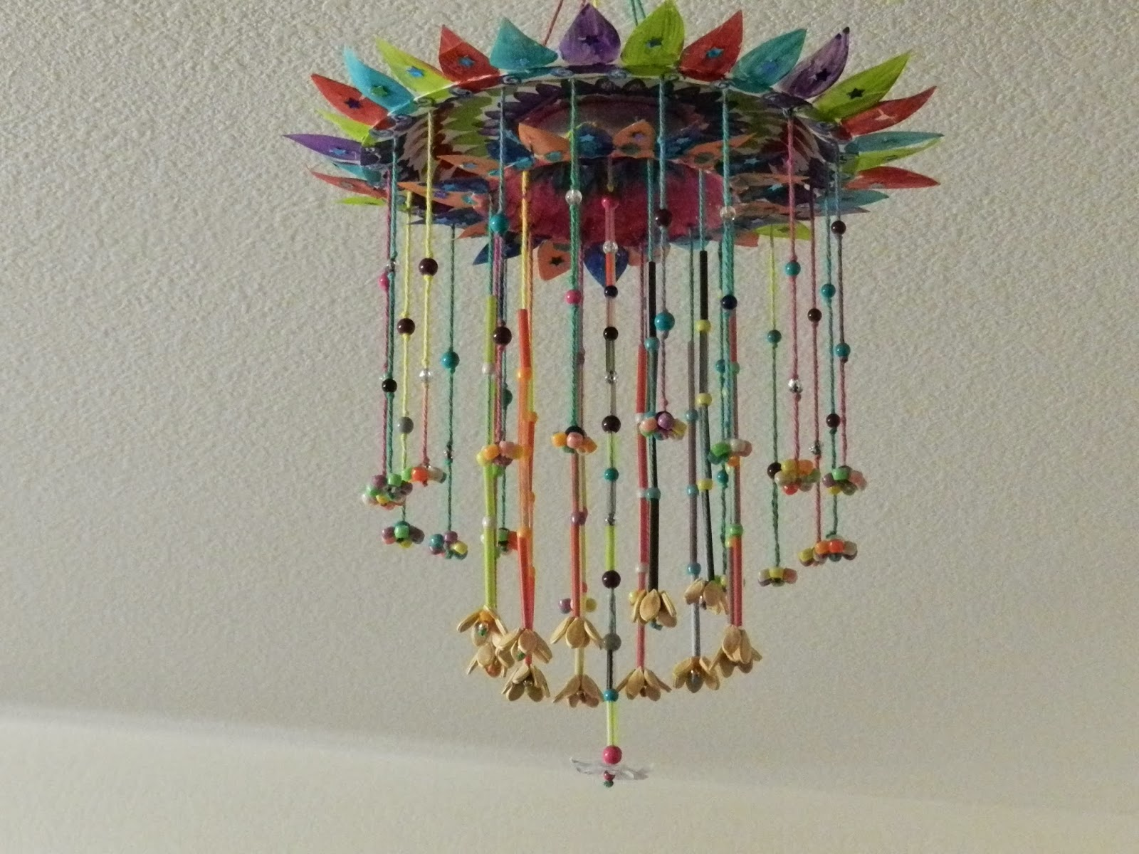 Creative diy crafts paper plate hanging craft with beads for Use of waste material in decoration