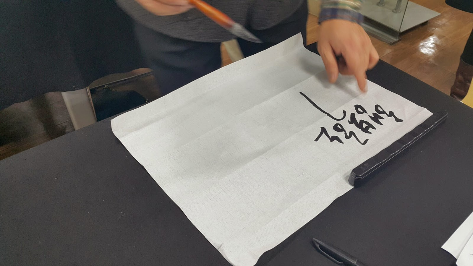 The italicized Korean calligraphy style.