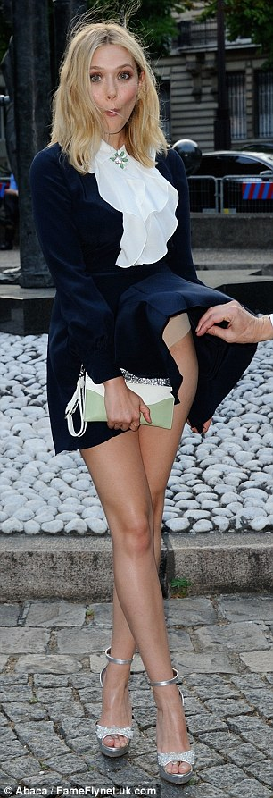 Elizabeth Olsen flashes underwear at the Miu Miu Fragrance and Croisiere Collection 2016 launch in Paris