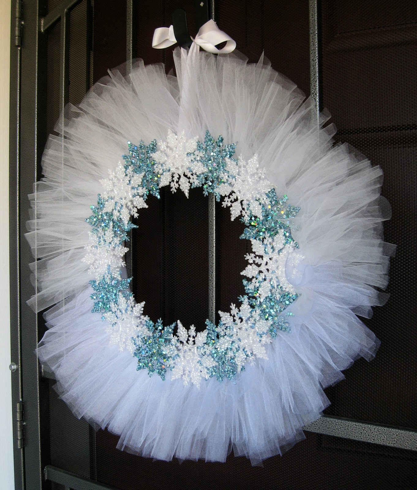 There are a few optional supplies, but really the only things you have to have is a styrofoam wreath form and some tulle. Normally I use ″ wreath forms, but for this you'll want a small 8 inch one. It looks tiny, but in the end it will appear much larger, so it's better to start out with something small! I had 2 spools of tulle that were 50 yards each and I used almost all of it.