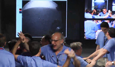 Curiosity MSL lands on Mars. Entry, Descent and Landing (EDL) team in blue shirts celebrate the first picture from Curiosity. 6 August 2012. NASA/JPL.
