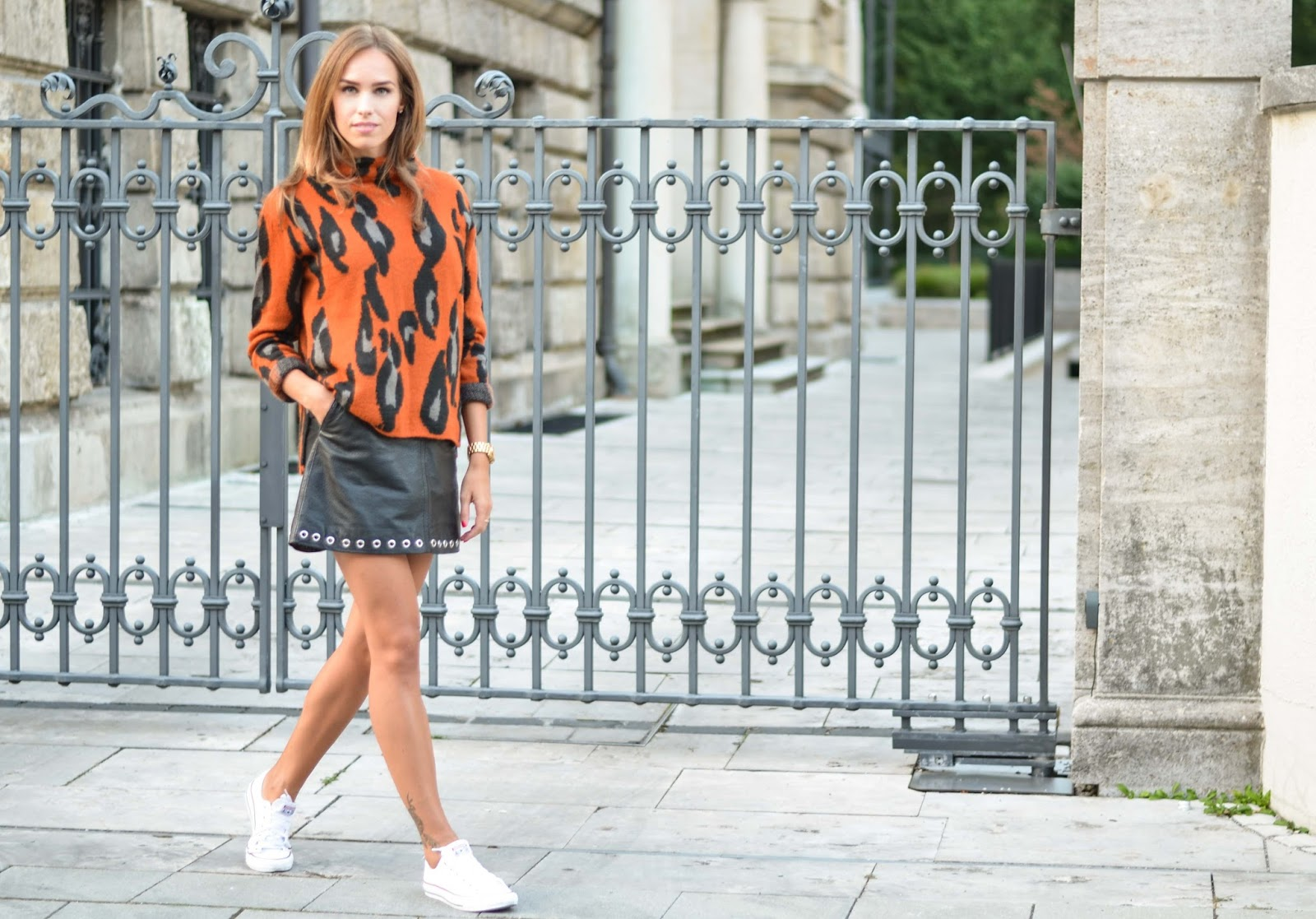 kristjaana mere orange leopard print sweater black mini leather skirt