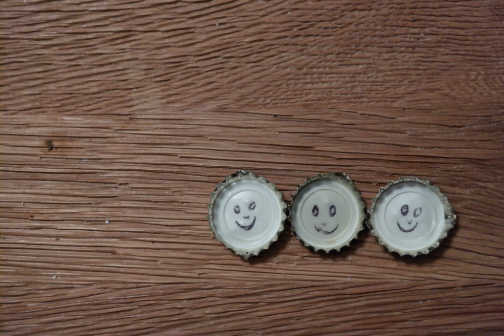 Smiles drawn inside bottle caps
