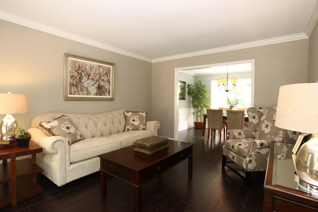 I Love The Bold Flower Pattern In The Chair And Pillows On The Couch In  This Living Room. The Bold Pattern Keeps The Neutral Color Scheme From  Looking ...