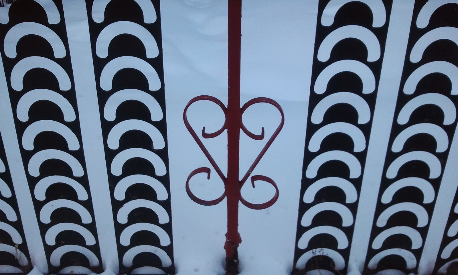 heart-shaped black and red fence