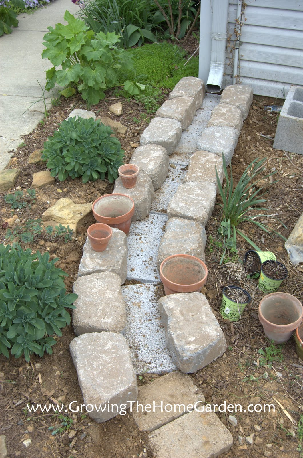 Making A Dry Creek Bed Drainage Canal For Downspouts