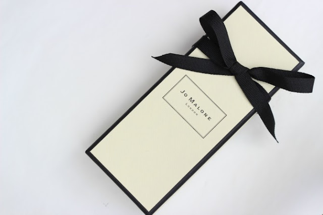 Jo Malone perfume, boxed with a bow