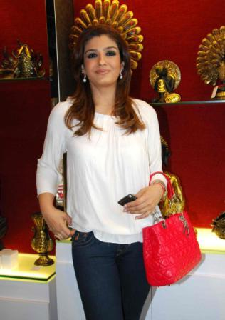 Raveena Tandon in white Top - Raveena Tandon Launches Viva Sole Store
