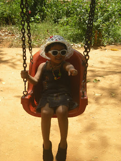 aishi on swing at bannerghatta national park