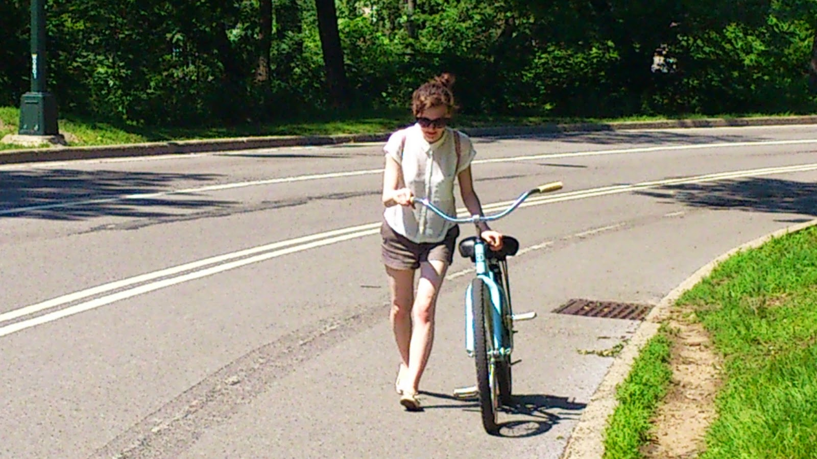 new york city central park bike uphill nature girl