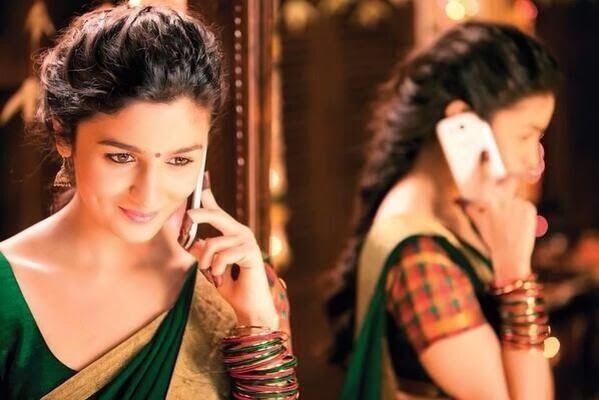 Alia Bhatt in traditional South Indian sari, talking on phone in 2 States movie