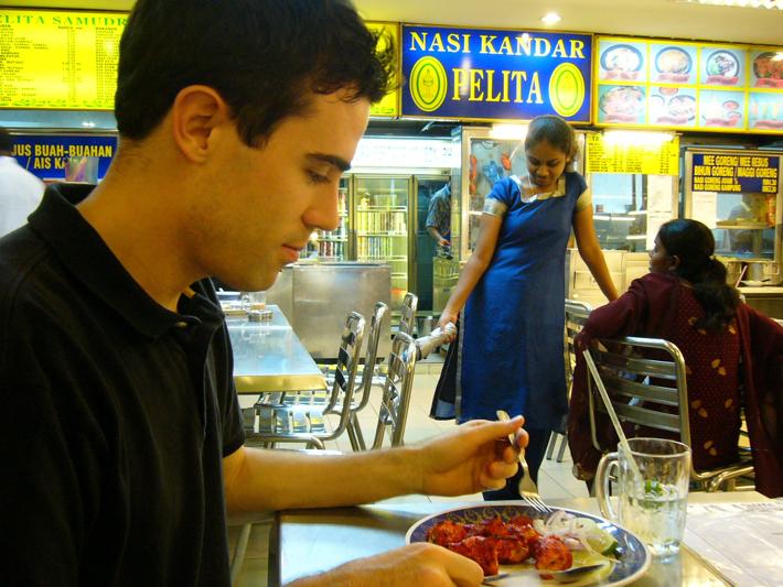 Eating tandoori chicken in Penang Malaysia