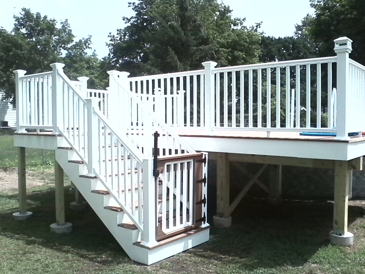Trex Composite Decking With Severe Weather Railing And Clad Frame Wrapping