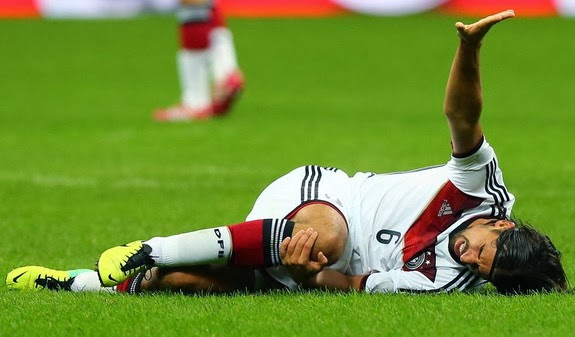 Germany player Sami Khedira reacts after being injured during a match against Italy