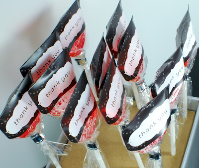 charcoal thank you labels on sweetened grapefruit hard candy lollipops