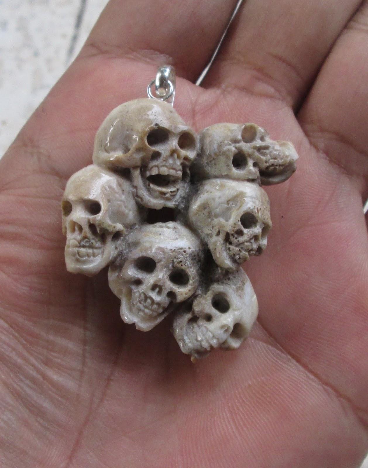 Skull Group Carved Bone Pendant