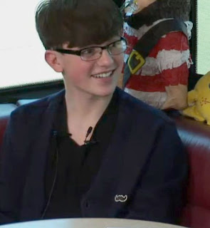 Greyson Chance wearing Glasses 2013 Video Tour Bus