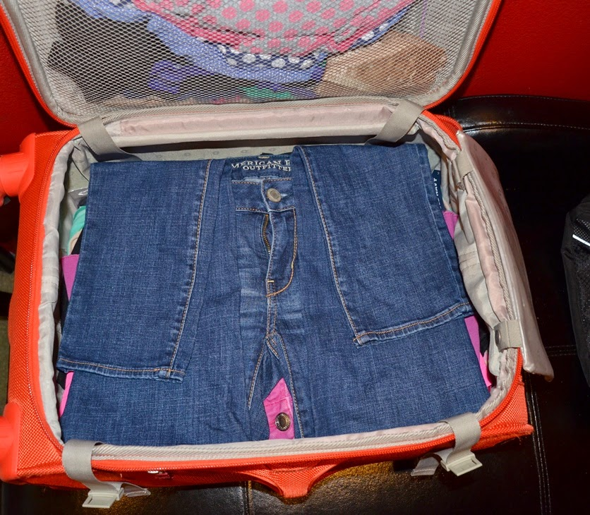how to pack a suitcase with a lot of stuff