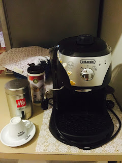 delonghi coffee machine, lavazza espresso, starbucks mug