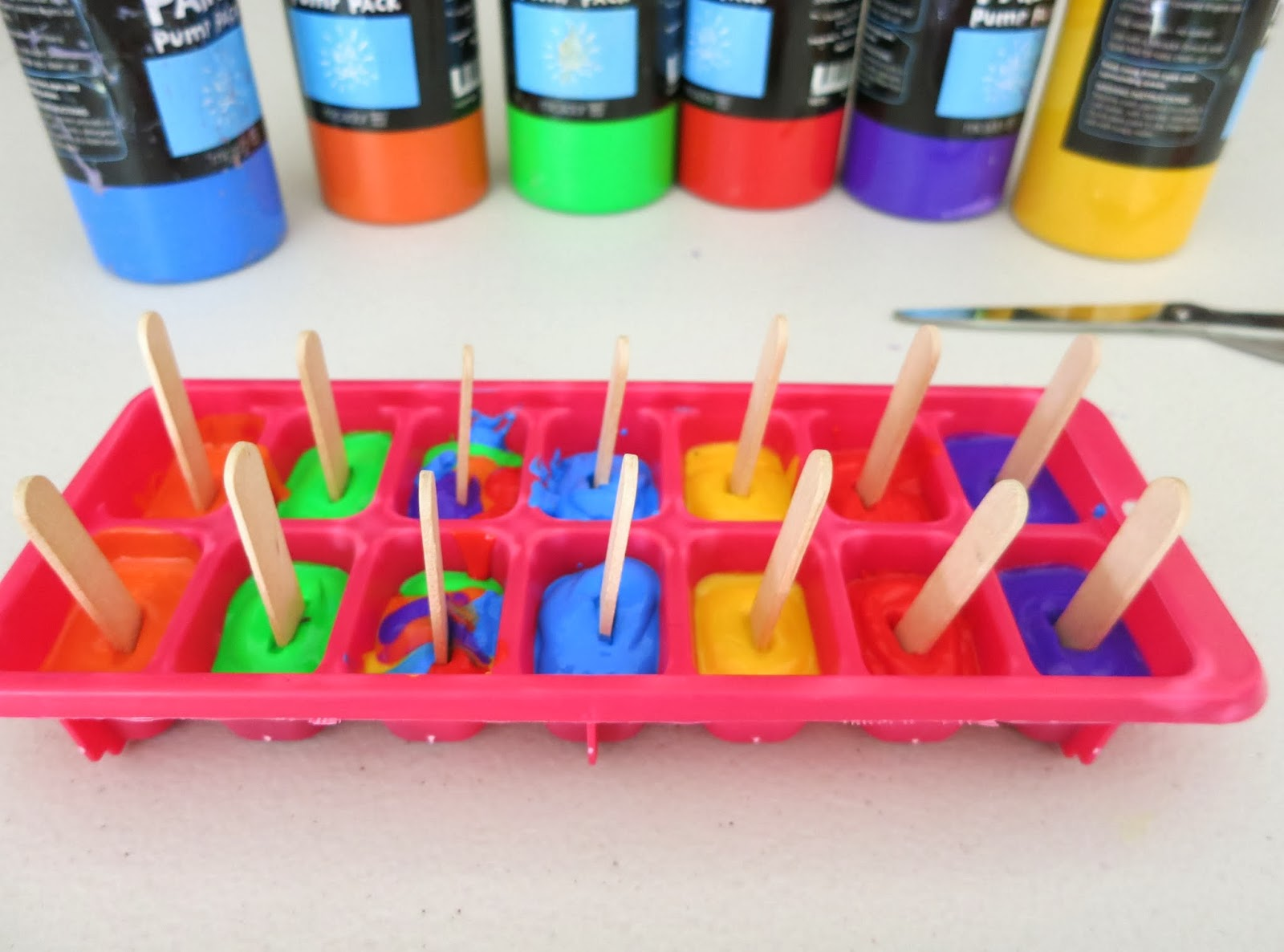 Learn with play at home paintsicles frozen paint cubes for Awesome crafts to do at home
