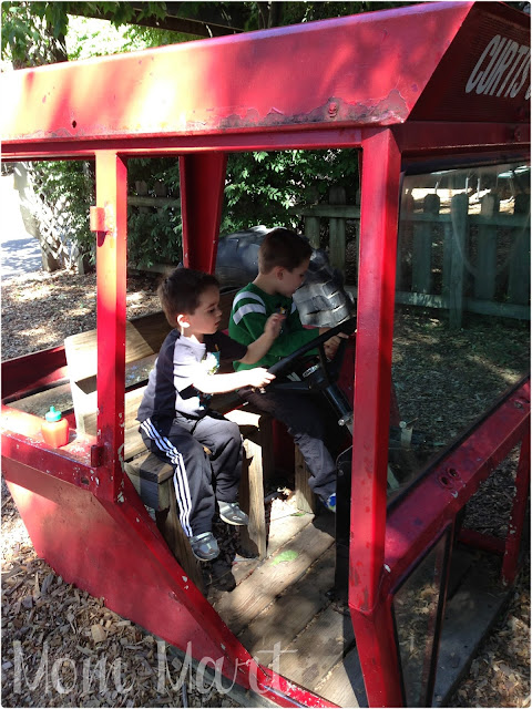 The boys playing in what used to be a tractor!