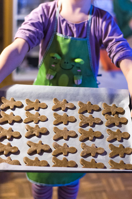 Gingerbread man cookies before baking on plate