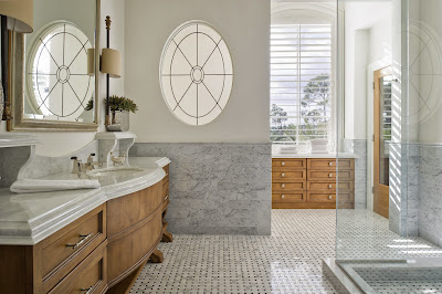 modern white bathroom with beautiful vanity counter and big windows that provides natural lights and view