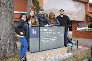 Cj Ambassadors stand outside the Beto Criminal Justice Center.