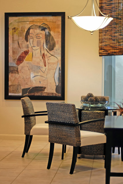 dining room area having contemporary painting