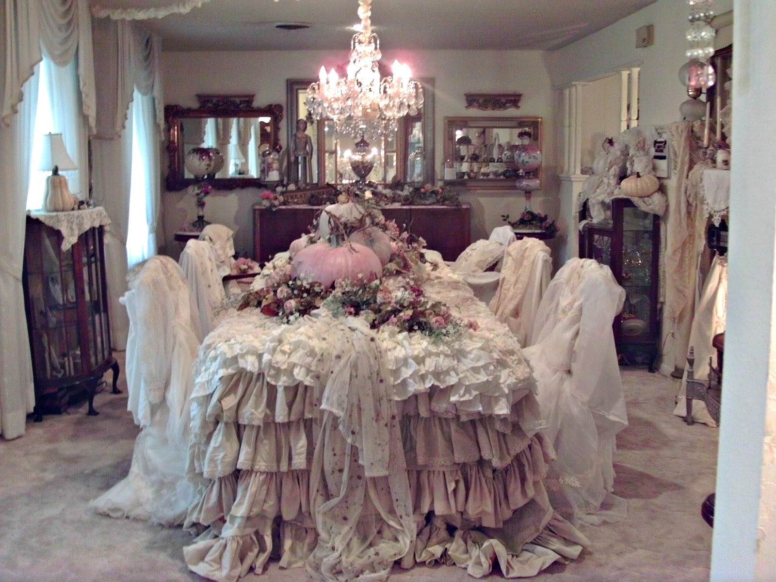 in this photo the formal dining room is ready for thanksgiving with