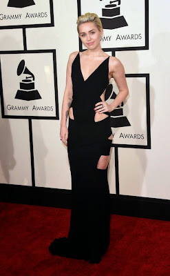 Miley Cyrus sexy in cut-out dress by Alex Vauthier gown at 2015 Grammy Awards red carpet