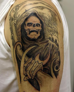 Grim Reaper tattoo covering the shoulder and the upper arm