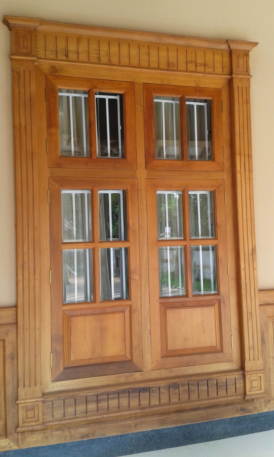 Kerala style carpenter works and designs main entrance wooden window frame and door designs - House window design photos ...