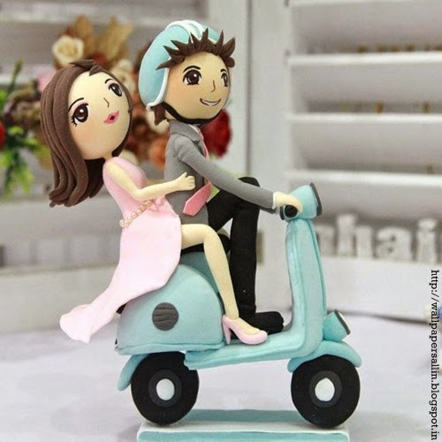 doll couple on bike