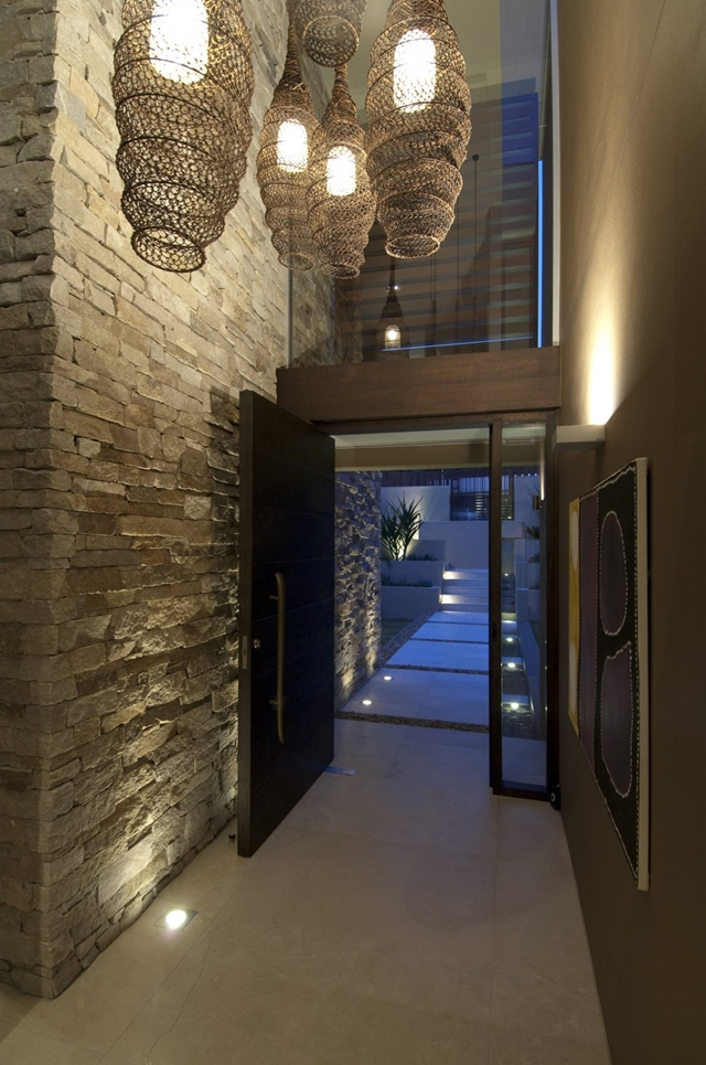Entrance doors and stone wall in the hallway