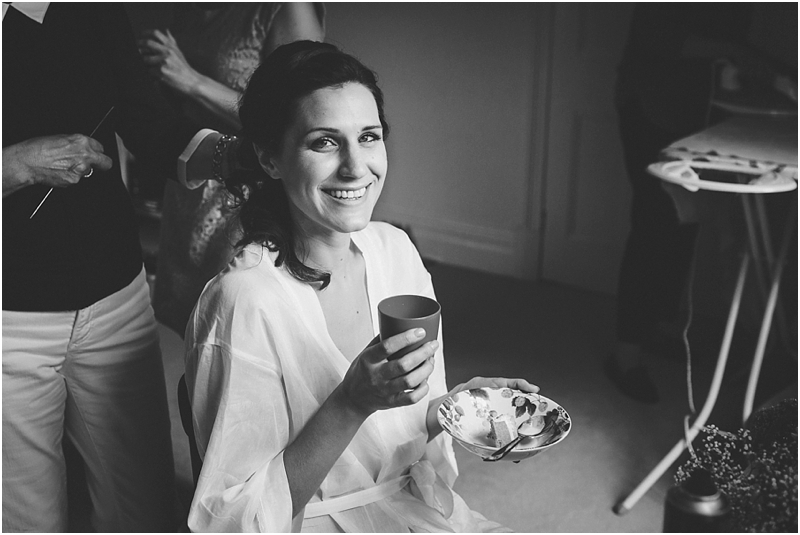 Bride with drink and food before wedding
