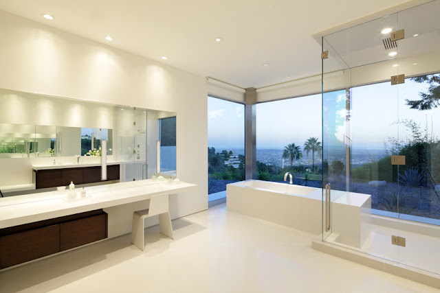 Large minimal bathroom with glass walls