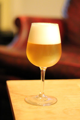A glass of spelt saison fermented with White Labs Saison III.