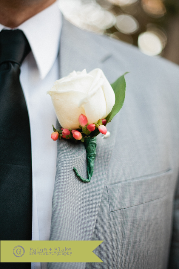 Groom's boutonniere - Pink and white : Photo by Paige and Blake Green
