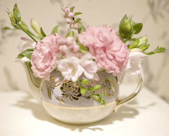 flowers in a vintge teapot