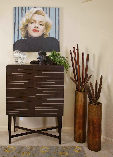 minimalist wooden cabinet along with bamboo containers and sexy Marilynn Monroe face painting