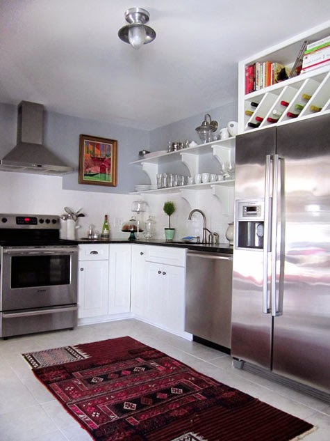 maximizing stylish space above fridge