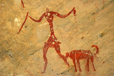 cave painting of a man with a dog