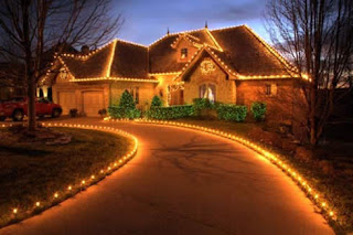 Christmas lights decorated both sides path entrance way to the home image