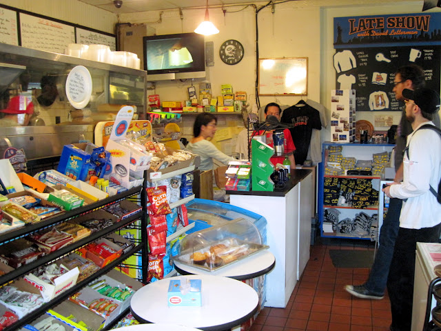 A sandwich and a tshirt please, at the Hello Deli, deli and tshirt stand.