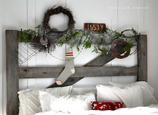 An old gate headboard decked out for Christmas - via Funky Junk Interiors