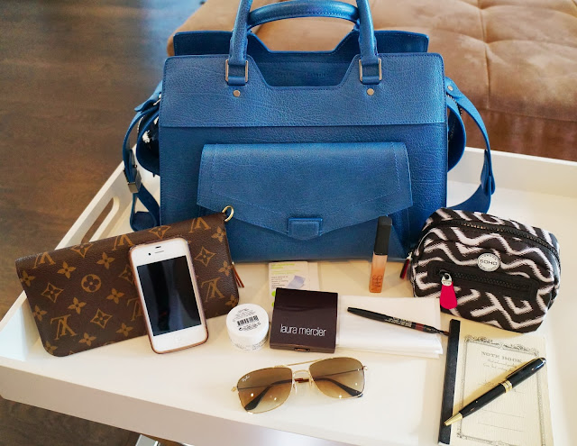 My blue proenza schouler with its contents in front of it