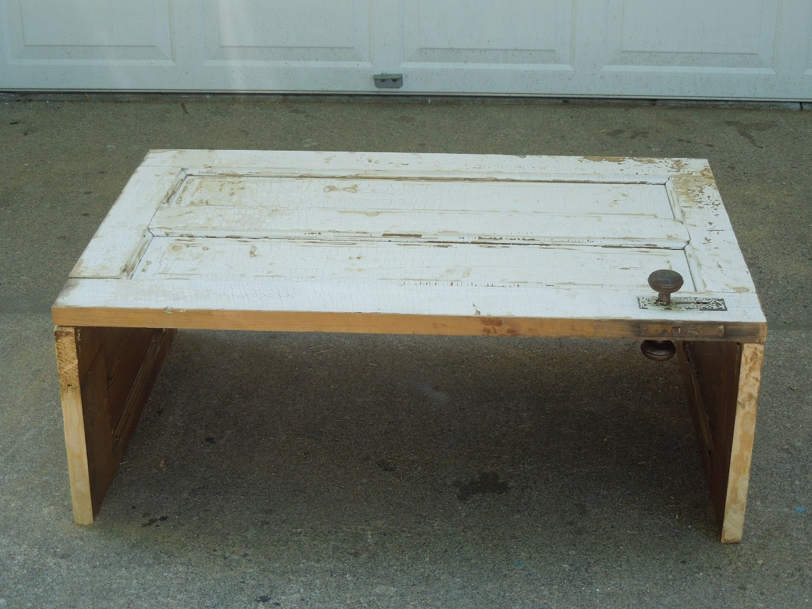 tattered lantern: old door coffee table $69.00 (sold)