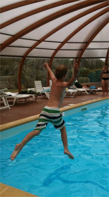 Child jumping into swimming pool