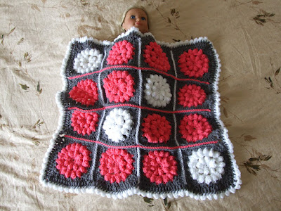 Crochet Something Pretty Doll Blanket/Toddler Lap Blanket. Link to free pattern by Mille Makes in post.
